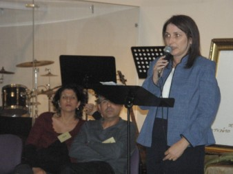 Tammy sharing her testimony at the opening of Woven with Gold # 4